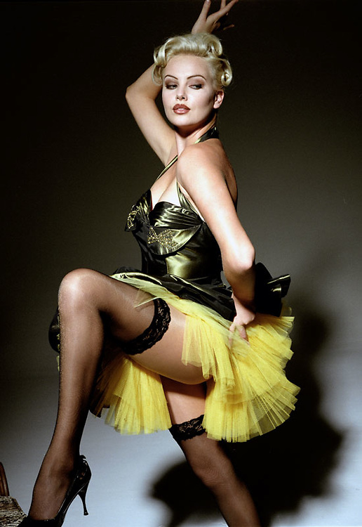 High-fashion stylized photo shoot with Charlize Theron by Nino Via