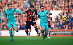 BOURNEMOUTH, ENGLAND - Sunday, November 25, 2018: Arsenal's Rob Holding (L), Sokratis Papastathopoulos (R) and AFC Bournemouth's Callum Wilson (C) during the FA Premier League match between AFC Bournemouth and Arsenal FC at the Vitality Stadium. (Pic by David Rawcliffe/Propaganda)