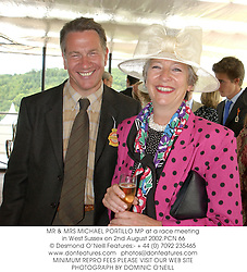 MR & MRS MICHAEL PORTILLO MP at a race meeting in West Sussex on 2nd August 2002.PCN 66