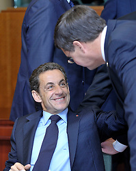 "Nicolas Sarkozy, France's president, left, speaks with Jan Peter Balkenende, the Netherlands's prime minister, during the European Union Summit at the EU headquarters in Brussels, Belgium, on Thursday, Oct. 29, 2009. European Union leaders are set for ""very difficult"" talks to overcome the Czech Republic's resistance to a new governing treaty designed to strengthen the EU's influence in world affairs, Reinfeldt said. (Photo © Jock Fistick)"