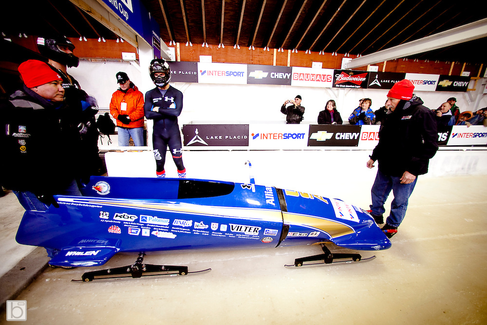 Nov 21, 2009:  USA's driver John Napier with brakeman Charles Berkeley prepare for their 1st run start while coaches attend the sled at the Intersport FIBT World Cup 2-Man Bobsled at the Olympic Sports Complex, Lake Placid, N.Y. Napier stands in first place after one run.  (ORDA Photo ©Todd Bissonette)