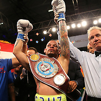 KISSIMMEE, FL - JULY 15: Orlando Cruz raises his arms after his victory over Alejandro Valdez during a boxing match at the Kissimmee Civic Center on July 15, 2016 in Kissimmee, Florida. Cruz was the first professional boxer to announce himself as gay and recently lost four friends in the Pulse Nightclub shooting in Orlando, he dedicated this match to his lost friends and won the bout by TKO in the 7th round.  (Photo by Alex Menendez/Getty Images) *** Local Caption *** Orlando Cruz; Alejandro Valdez