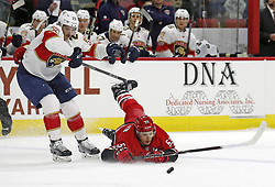 November 7, 2017 - Raleigh, NC, USA - The Carolina Hurricanes' Jeff Skinner (53) hits the ice as he is tripped up by the Flordia Panthers' Connor Brickley (23) during the first period at PNC Arena in Raleigh, N.C., on Tuesday, Nov. 7, 2017. Brickley was called for a penalty on the play. (Credit Image: © Chris Seward/TNS via ZUMA Wire)