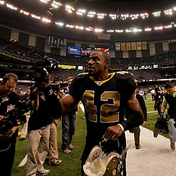 2009 November 02: New Orleans Saints safety Darren Sharper (42) runs off the field following a 35-27 win over the Atlanta Falcons at the Louisiana Superdome in New Orleans, Louisiana.