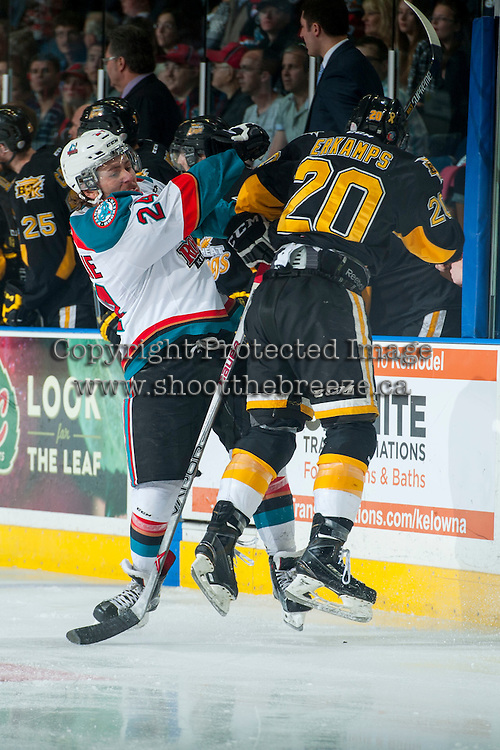 KELOWNA, CANADA - MAY 11: Tyson Baillie #24 of Kelowna Rockets checks Macoy Erkamps #20 of Brandon Wheat Kings during first period on May 11, 2015 during game 3 of the WHL final series at Prospera Place in Kelowna, British Columbia, Canada.  (Photo by Marissa Baecker/Shoot the Breeze)  *** Local Caption *** Tyson Baillie; Macoy Erkamps;