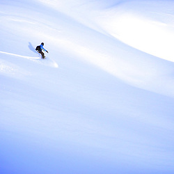 Pedro Patri?cio, rider and Photographer in a lunar powder landscape in the Val Gardena backcountry area.