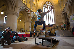 "© Licensed to London News Pictures 14/02/2018, Malmesbury, UK. Luke Cooper from Basildon gets some jumps in at the 10th anniversary of ""Malmesbury Skate"", a skating festival that is set up inside Malmesbury Abbey (a former Benedictine Abbey) during school half term.Photo Credit : Stephen Shepherd/LNP"