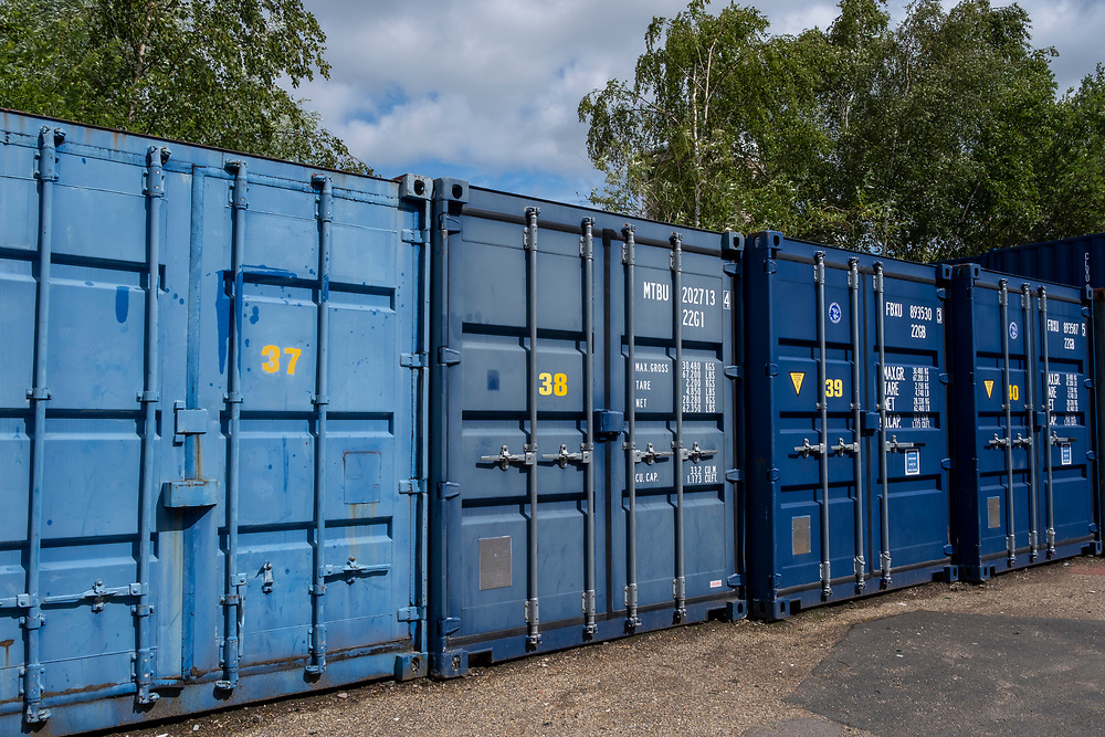 A row of numbered blue metal storage shipping containers in a self-storage depot in Aldershot, Hampshire, UK.  (photo by Andrew Aitchison / In pictures via Getty Images)