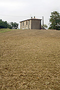 single house on a hill in an agricultural field