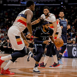 Jan 7, 2019; New Orleans, LA, USA; Memphis Grizzlies guard Mike Conley (11) drives past New Orleans Pelicans forward Julius Randle (30) and forward Anthony Davis (23) during the first quarter at the Smoothie King Center. Mandatory Credit: Derick E. Hingle-USA TODAY Sports