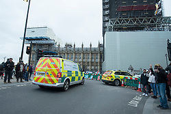 © Licensed to London News Pictures. 18/10/2019. LONDON, UK.  Incident response unit arrives as a climate activist (top right) from Extinction Rebellion scales the construction scaffolding of the Queen Elizabeth Tower in Westminster.  Parliament Square and the surrounding area has been brought to a standstill as police and emergency services assess the situation.  Photo credit: Stephen Chung/LNP