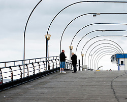 Cleethorpes Pier originally cost £8,000 to build , was largely financed by railway companies serving the cities of Sheffield and Manchester and the county of Lincolnshire. Officially opened on August Bank Holiday Monday 1873.It is 1,200 feet (370 m) in length to span the unusually large distance between low and high tide limits, and is comprised a timber deck and pavilion constructed in 1888, supported on iron piles. A section was, however, cut out of the pier during the Second World War to impede its use in any German invasion attempt...1 July 2012.Image © Paul David Drabble