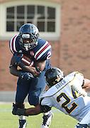 Samford running back Fabian Truss (2) gets tackled by Appalachian State linebacker Brandon Grier (24) at Seibert Stadium in Homewood, Ala., Saturday, Oct 13, 2012. (Marvin Gentry)