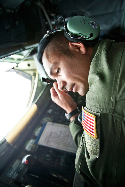 Staff Sergeant Jason Grant takes a moment of respite following the refueling of the U.S.A.F. Thunderbirds during the media tour aboard the KC-135R Stratotanker..