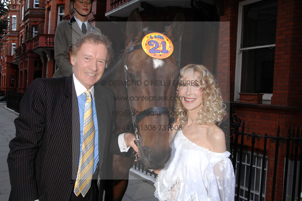 RICHARD & BASIA BRIGGS and Leopold the horse at a party to celebrate the 21st birthday of one of their horses Leopold, held at 35 Sloane Gardens, London W1 on 10th September 2007.<br />