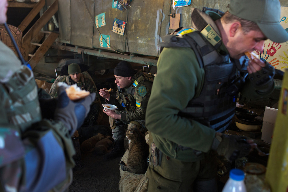 Members of Dnipro-1 Battalion eat under a fortified bridge about two kilometers from the front on March 9, 2015 near Pisky, Ukraine.