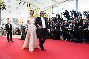 Alain Delon and Marine Lorphelin attend the 'Zulu' Premiere and Closing Ceremony during the 66th Annual Cannes Film Festival at the Palais des Festivals on May 26, 2013 in Cannes, France