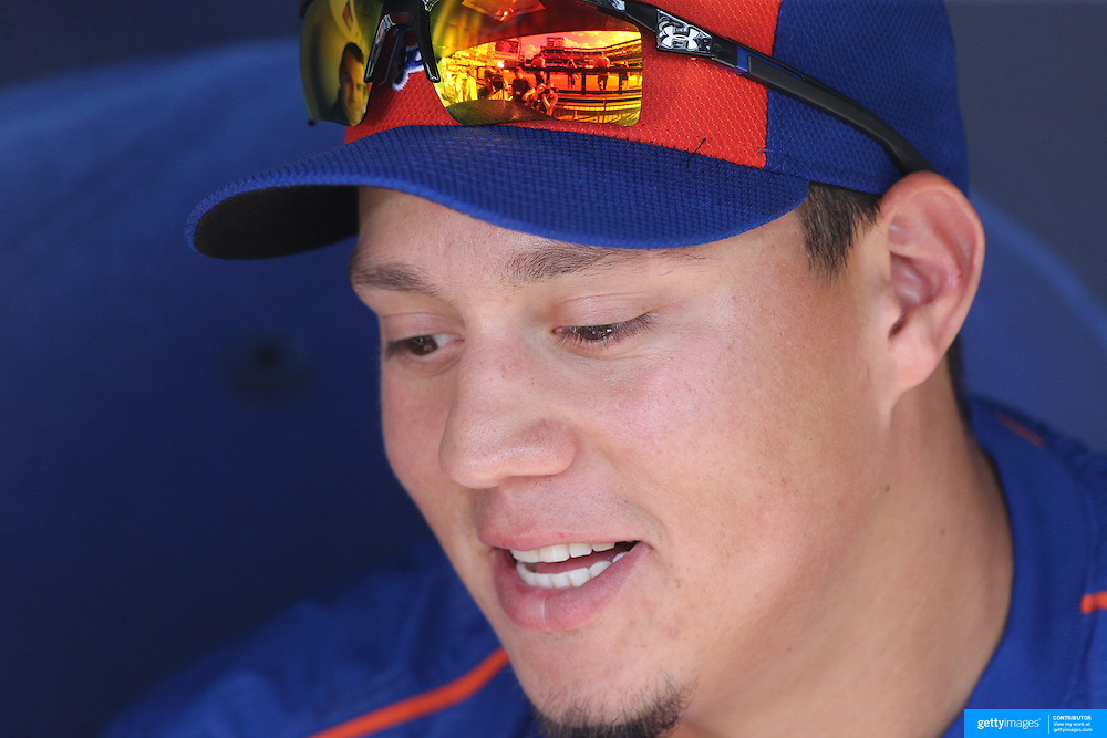 Wilmer Flores, New York Mets, reflecting on his week with a reporter in the dugout before the New York Mets Vs Washington Nationals. MLB regular season baseball game at Citi Field, Queens, New York. USA. 1st August 2015. Photo Tim Clayton