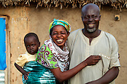 Balila's parents outside their home in Tinguri, northern Ghana.