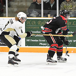 TRENTON, ON - Apr 22, 2016 -  Ontario Junior Hockey League game action between the against the Trenton Golden Hawks and the Georgetown Raiders. Game 5 of the Buckland Cup Championship Series, at the Duncan Memorial Gardens in Trenton, Ontario. Liam Morgan #8 of the Trenton Golden Hawks tries to keep the puck from Brendan Jacome #25 of the Georgetown Raiders during the second period.<br /> (Photo by Andy Corneau / OJHL Images)