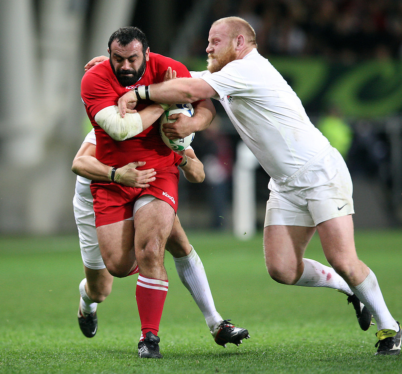 Georgia's David Zirakashvili, left, fends off England's Dan Cole in the Rugby World Cup pool match at Otago Stadium, Dunedin, New Zealand, Sunday, September 18, 2011. Credit:SNPA / Dianne Manson.