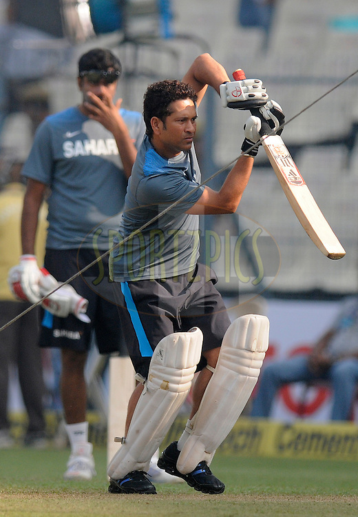 Sachin Tendulkar of India bats at the nets before the start of play on day two of the first Star Sports test match between India and The West Indies held at The Eden Gardens Stadium in Kolkata, India on the 7th November 2013<br /> <br /> Photo by: Pal Pillai - BCCI - SPORTZPICS