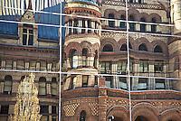 Old City Hall designed by Toronto architect Edward James Lennox reflecting in adjacent building.