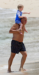 EXCLUSIVE: Coleen Rooney's dad Tony seen on the beach with grandsons in Barbados. 20 May 2018 Pictured: Coleen Rooney's dad Tony. Photo credit: MEGA TheMegaAgency.com +1 888 505 6342