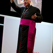 Archbishop Timothy Dolan gives  a catecesis session at Palacio des Desportes (the English Speaking Stadium)