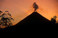 Arenal Volcano erupting at sunrise. Lake Arenal in foreground. Costa Rica.<br />
