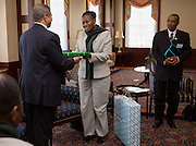 Ohio University President Roderick McDavis, left, exhanges gifts with Mrs. Grace Muzila, of the Ministry of Education Skills and Development, Botswana, right, before a luncheon at Baker Center on January 21, 2014. The discussion and luncheon were hosted by the Ohio University Center for International Studies.