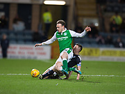 24th January 2018, Dens Park, Dundee, Scottish Premiership, Dundee versus Hibernian; Dundee's Cammy Kerr tackles Hibernian's Brandon Barker