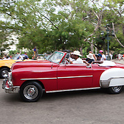 Parque Central, a tourist area in Old Havana where classic, colorful cars or horse-drawn coaches offer their taxi services to tourists.  <br /> Photography by Jose More