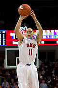 DALLAS, TX - JANUARY 21: Nic Moore #11 of the SMU Mustangs shoots the ball against the Rutgers Scarlet Knights on January 21, 2014 at Moody Coliseum in Dallas, Texas.  (Photo by Cooper Neill/Getty Images) *** Local Caption *** Nic Moore