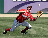 Nebraska right fielder Luke Gorsett makes a diving catch in the bottom of the first inning agaisnt Kansas State.  Nebraska held on to beat Kansas State 5-4 at Tointon Stadium in Manhattan, Kansas, April 1, 2006.