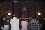 People pray inside Fujisan Hongu Sengen Taisha in Fujinomiya City, Shizuoka Prefecture Japan on 01 Oct. 2012.  Photographer: Robert Gilhooly