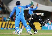India's Mahendra Singh Dhoni runs out Black Caps Jimmy Neesham during the Fifth ODI of the 2019 ANZ International ODI Series. Blackcaps v India at Westpac Stadium, Wellington, Sunday 3rd February 2019. © Copyright Photo: Grant Down / www.photosport.nz