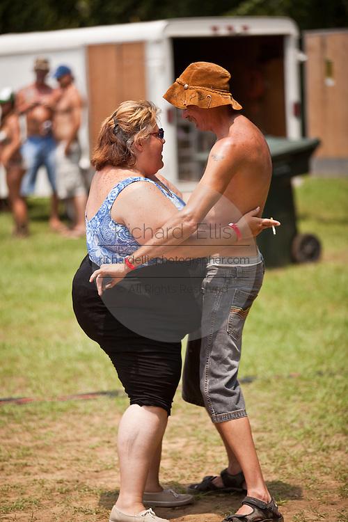 A couple dance during the annual Summer Redneck Games Dublin, GA.
