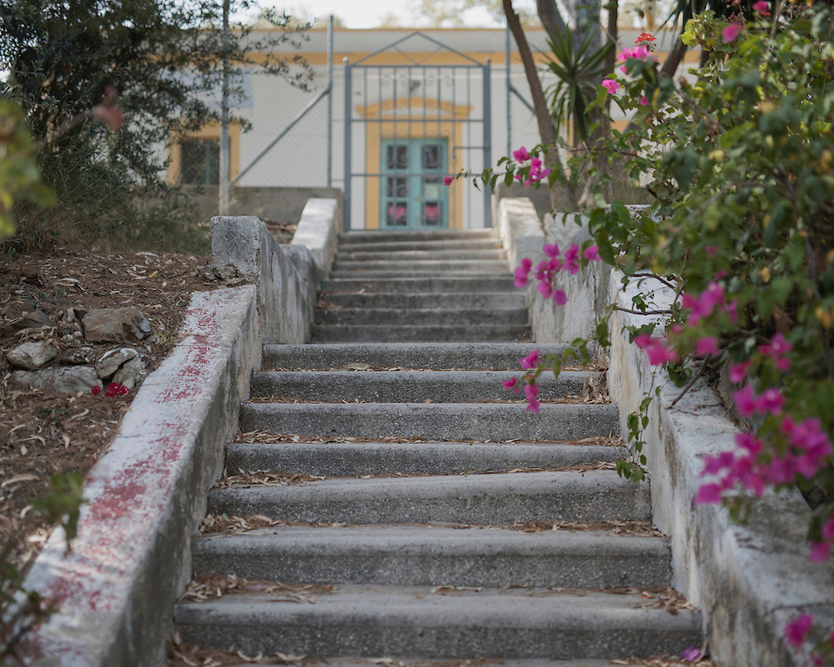 A stairway leading to the entrance of Villa Artemis, a shelter for 30 refugee women and their children in the grounds of Leros Hospital. <br /> Opened in September 2015, the shelter was run by the Leros Solidarity Network. However, Villa Artemis was closed down shortly after the opening of a 'Hotspot' (EU-run migrant's reception centres) camp in Lepida in February 2016.