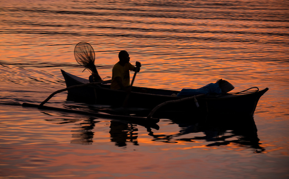 """Fisherman coming into Sarangani village at the end of the day.<br /> <br /> The SARANGANS showcase enormous cultural diversity of Blaan, Tboli, Tagakaolo, Kalagan, Manobo, Ubo, Muslim tribes and Christian settlers. Hospitable and fun-loving """"Sarangans"""" (people of Sarangani) adhere to a unified direction for development.<br /> Muslim consists of 7 groups; the Lumads, 17; and the migrant settlers, at least 20. The Blaans characterize the largest minority and are distributed in the municipalities of Malapatan, Glan, Alabel, Maasim, and Malungon. A bulk of this tribe is found in Malapatan constituting 37% of the municipal household population.<br /> The Maguindanaos are settled in the municipalities of Malapatan, Maitum, and Maasim; Tbolis reside mostly in Maitum, Kiamba, and Maasim while Tagakaolos subsist entirely in Malungon.<br /> Cebuano settlers are found in Glan and Alabel; Ilonggos are situated in Malungon while the Ilocanos live mostly in Kiamba and Maitum.<br /> Thus, Sarangani's mixed population of Cebuano-speaking Blaans and Muslims in the east coast, Ilocano-speaking Tbolis, Manobos and Muslims in the west coast, and Ilonggo-speaking Blaans and Kaolos in the north uplands, is unique and in harmony."""