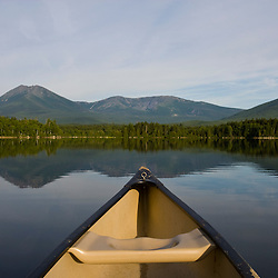 The bow of a canoe points towards Mount Katahdin as seen from Katahdin Lake in Maine's Baxter State Park.