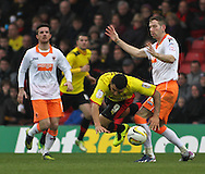 Picture by David Horn/Focus Images Ltd +44 7545 970036.09/03/2013.Troy Deeney of Watford is fouled by Kirk Broadfoot of Blackpool during the npower Championship match at Vicarage Road, Watford.