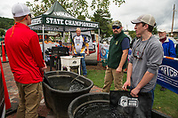 Teams line up for the weigh in by John Foster and Ray Meyer of Bass Association during the NHIAA State Bass Fishing Qualifier held on Lake Winnipesaukee from Center Harbor Beach on Thursday.  (Karen Bobotas/for the Laconia Daily Sun)