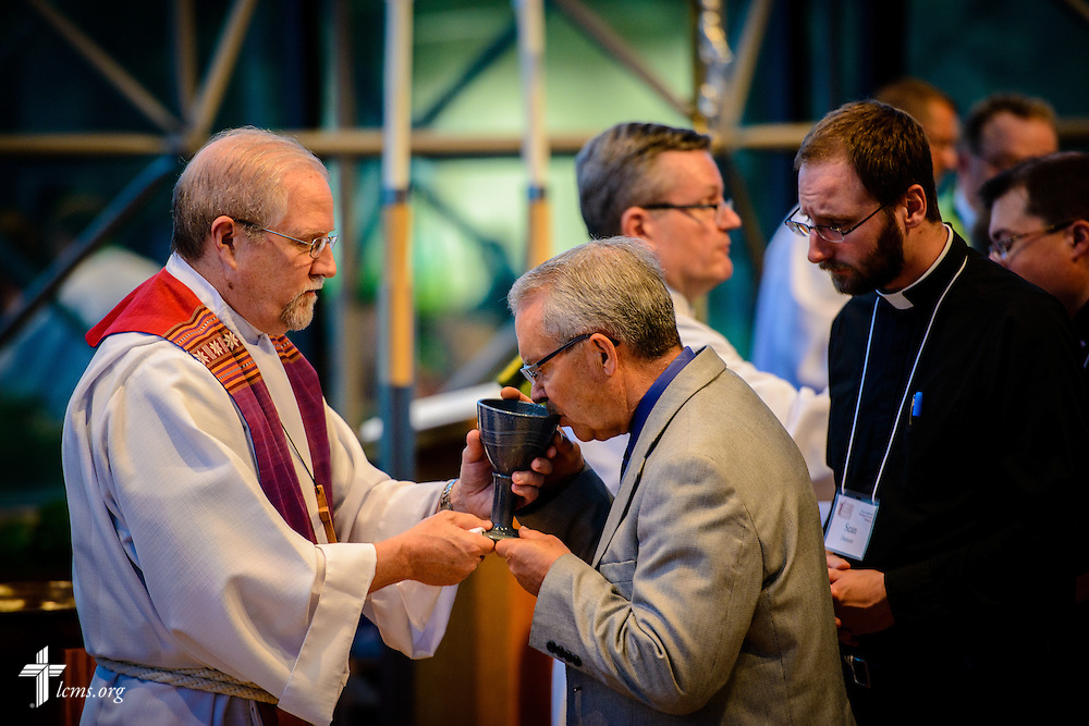 The Rev. John Fale, executive director of LCMS Office of International Mission, distributes the sacrament at worship during floor-committee weekend at the International Center of The Lutheran Church–Missouri Synod on Saturday, May 28, 2016, in Kirkwood, Mo. LCMS Communications/Erik M. Lunsford