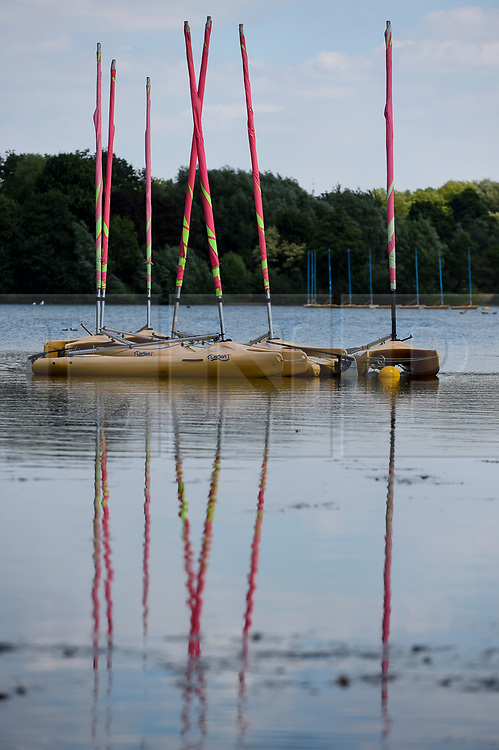 © Licensed to London News Pictures. 23/07/2018. LONDON, UK. The colourful masts of small boats are reflected in water during hot weather at Rickmansworth Aquadrome in north west London, on a day when temperatures reached 30C.  Temperatures up to 35C are forecast for the rest of the week during the current heatwave.  Photo credit: Stephen Chung/LNP