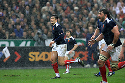Francois Trinh-Duc advances for France as the rain pours during the Six Nations rugby union tournament final match France versus England on March 20, 2010 at the Stade de France in Saint-Denis, north of Paris.