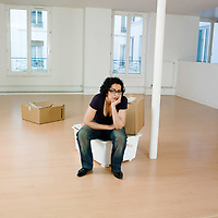 man sitting on the floor inside an empty loft appartement