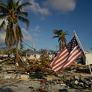 MARATHON, FL - SEPTEMBER 16: <br /> An American flag flies amid the destruction in the Sea Breeze trailer park in Plantation Key on September 16, 2017 in Marathon, Florida.  (Photo by Angel Valentin/Getty Images)
