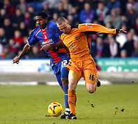 Photo: Chris Ratcliffe.<br />Crystal Palace v Wolverhampton Wanderers. Coca Cola Championship. 10/12/2005.<br />Mikele Leigertwood (L) of Palace tussles with Kenny Miller of Wolves