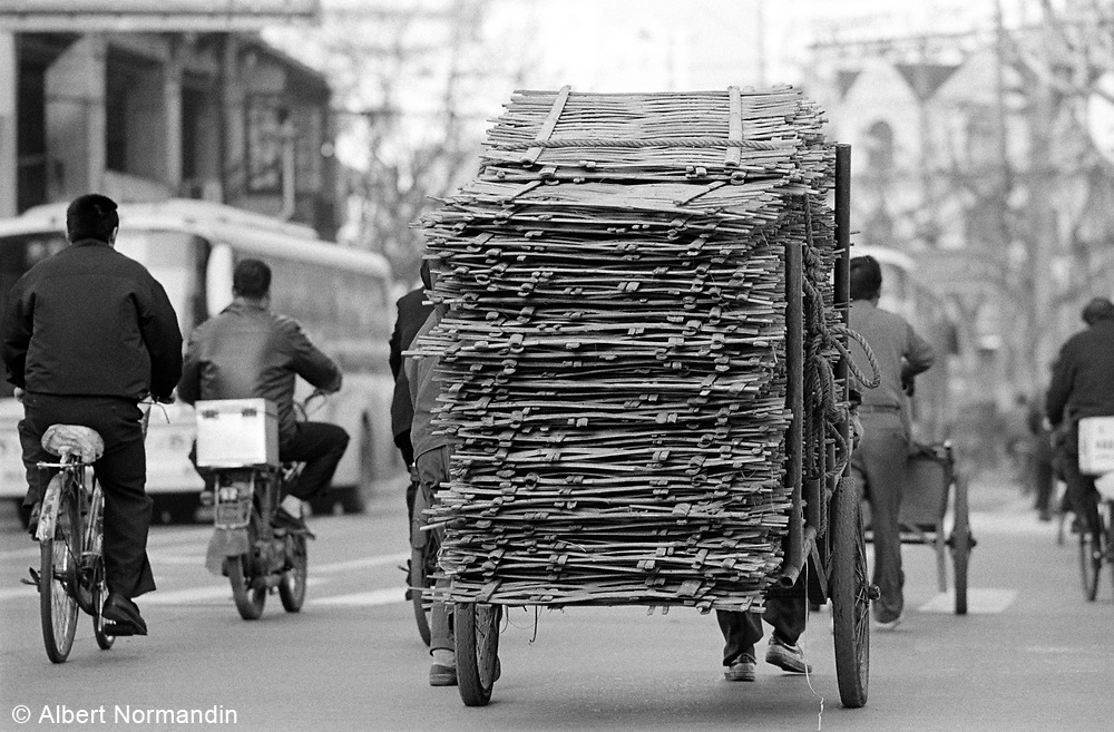 heavy load with bicycles in the streets old city of Shanghai